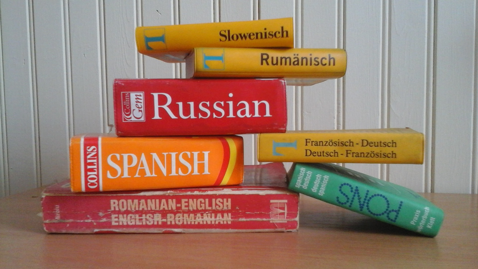 Dictionaries in several languages are piled up on top of each other
